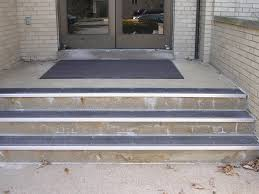 exterior stair treads and nosings. the same stairway, repaired with cement and stair repair renovation treads provides safe dependable access to egress from building. exterior nosings t