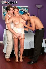 Busty old granny slut bea cummins having two stiff cocks to fuck.