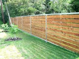 fence on uneven ground building