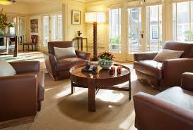 living room round table round center table living room eclectic with carved wood on bay window
