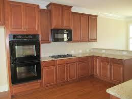Kitchens With Giallo Ornamental Granite Ballentine Gourmet Kitchen Timberlake Scottsdale Maple Cognac