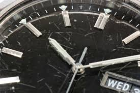 fixing scratches on a watch face