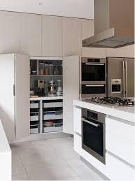 Mid-sized modern kitchen designs - Mid-sized minimalist ceramic floor  kitchen photo in
