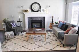 living room shag rug. Charming Living Room With Grey Fabric Upholstered Sofa And Square Wood Coffee Table Plus White Moroccan Shag Rug Floor Decor O