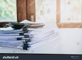 desk office file document paper. Stack Of Business Report Paper File On Modern White Office Desk With Bokeh Background.business Document