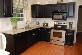 L Shaped Kitchen With Black Cabinets And Granite Countertops