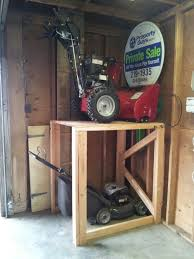 lawn mower garage storage. Garage Storage Shelving Units Racks Cabinets Intended Lawn Mower