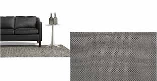 a woven pattern rug in black and white