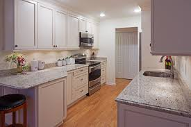 white galley kitchens. Example Of A Mid-sized Classic Galley Medium Tone Wood Floor Enclosed  Kitchen Design In White Kitchens