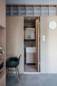 JAAK reconfigures Hong Kong apartment with space-saving cabinetry