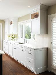 white cottage kitchen with wood floors