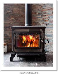 free art print of burning cast iron wood stove heating a new cast iron wood stove burning hot with slate tile freeart fa5691696