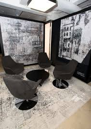 a private meeting area showcases carpet art deco s erased look rugs and art of living theme