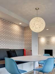 globe lighting fixture. example of a transitional medium tone wood floor dining room design in boston globe lighting fixture l