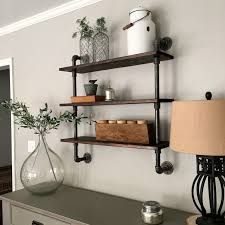 DIY: Pipe Shelving. Good idea for my son's ...