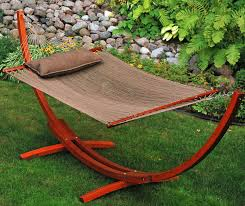 this bright red cedar wood frame hosts a flat woven spreader bar hammock and