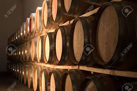 stacked oak barrels maturing red wine. Stacked Oak Barrels For Maturing Red Wine And Brandy In A Cooling Cellar. Made From