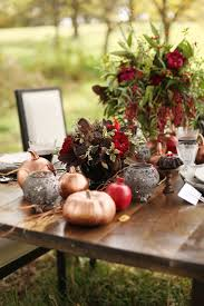 Let fall wedding tablescapes inspire your Thanksgiving table decor! Bronze  spray painted pumpkins and red