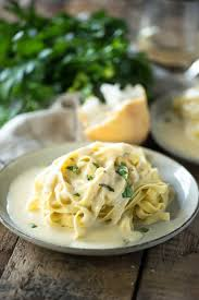 copycat copycat olive garden alfredo sauce an at home version of everyone s favorite breadstick dipping