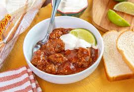 Beef chuck is braised with chilis, topped with avocado, cheese, scallions and served with tortillas for some deep flavored spice in every bite. Texas Red Chili Martin S Famous Potato Rolls And Bread