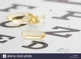Lying Eye Chart Vitamins Gel Capsules Lying On Eye Chart Stock Photo