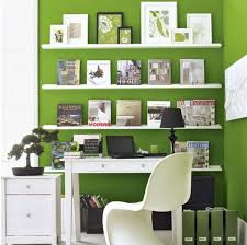 green office desk. corner home office space with green walls and white shelves i like the long wallmounted artwork above desk r