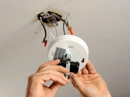 how to wire track lighting. Fine Wire A Man Removes A Lightu0027s Fixture Base From The Ceiling Throughout How To Wire Track Lighting S