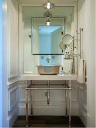 picturesque extension bathroom mirror inspiration for a dark wood floor  powder room remodel in phoenix with