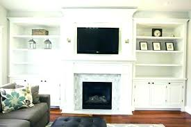 over fireplace tv cabinet mantle barn doors over fireplace mounting flat screen tv above brick fireplace