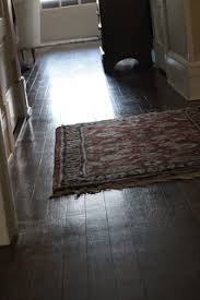 this photo shows my floor which by the way hasn t seen anything besides the swiffer all winter and it s pretty obvious that my floor is old