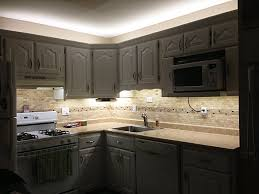 white balance led flexible light strip used to outfit kitchen cabinets with over and under lighting