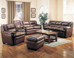 image of leather living room set with wood trim
