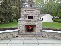 outdoor fondulac stone fireplace and pizza oven in st louis park mn traditional
