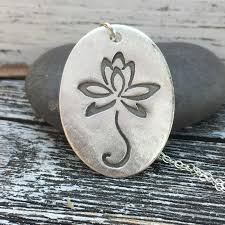 standing lotus flower silver oval pendant
