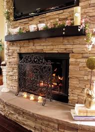 brannon idea for you new all stone to the ceiling fire place love the rounded siding and the little mantle below the tv