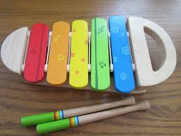 i introduced this wooden hape xylophone to little bee around 6 months he loved putting the sticks in his mouth and banging them onto the xylophone to hear
