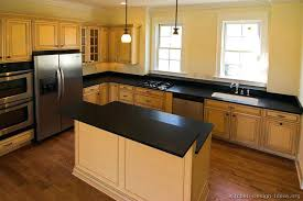 off white kitchen cabinets with black countertops. Unique White Black Countertop Kitchen Pictures Of Kitchens Traditional Off White Antique  Cabinets And Throughout With Countertops C