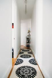 how you can dress up narrow spaces using hallway runners black rug runners for hallways