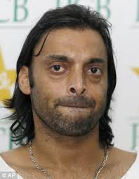 Pakistan fast bowler Shoaib Akhtar has been ruled out of next month's two-Test home series against Sri Lanka with a knee injury. - article-0-01F2075E000004B0-709_306x394