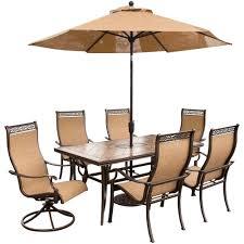 hanover monaco 7 piece rectangular patio dining set and 2 swivel rockers umbrella and