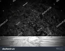 black table top texture. abstract natural black marble texture background on white floor : top view of table