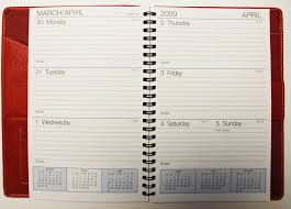 red weekly planner inside view