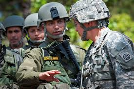u s department of defense photo essay n army capt rohit sapre left discusses tactics for searching weapon caches