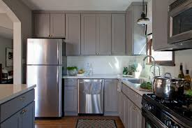 delightful design of grey kitchen cabinet in l shape with black stove also sink