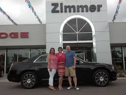 Here are Michael and Nicole Roth with sales consultant Diane ...
