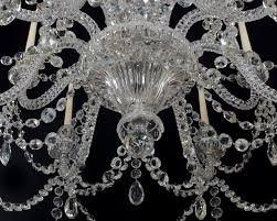 a superb quality twelve light antique chandelier and corresponding set of four wall lights by f c osler