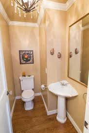 corner pedestal sink powder room traditional with brown walls chandelier chrome image by mac renovations ltd