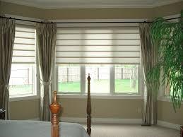 CafeStyleShuttersInASquareBayWindow  Surrey Blinds U0026 ShuttersBay Window Vertical Blinds