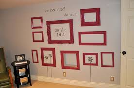 I love how these red empty frames pop in this darling craft room from I Am  Mama. What's really cool, is that the bottom middle frame is actually a  WINDOW ...