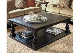 The faux marble top has a protective finish making it a smart choice for busy families. Mallacar Coffee Table Ashley Furniture Homestore